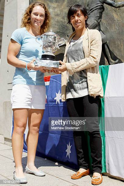 Samantha Stosur of Australia and Francesca Schiavone of Italy pose prior to the women's singles final match on day thirteen of the French Open at...