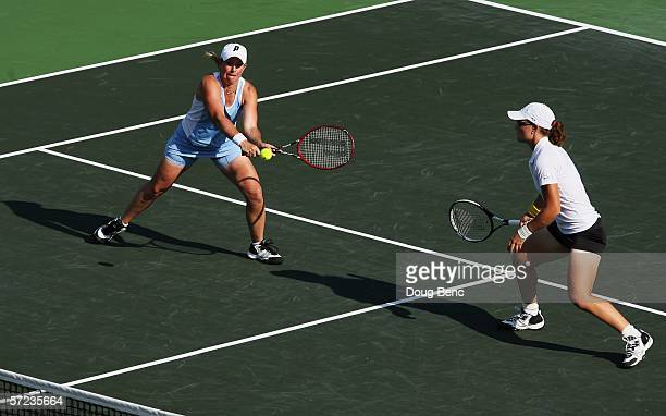 Samantha Stosur of Australia and Lisa Raymond return a shot to Martina Navratilova and Leisel Huber of South Africa during the women's doubles final...