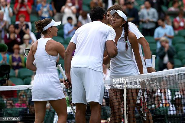 Samantha Stosur of Australia and Nenad Zimonjic of Serbia are congratulated by Max Mirnyi of Belarus and HaoChing Chun of Chinese Taipei after...