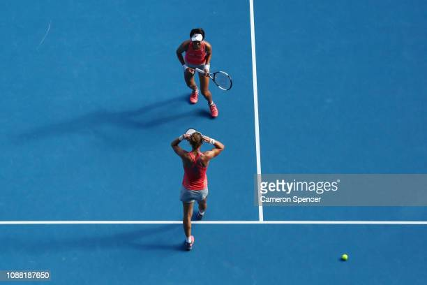 Samantha Stosur of Australia and Shuai Zhang of China celebrate championship point in their Women's Doubles Final match against Timea Babos of...