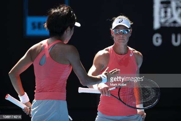 Samantha Stosur of Australia and Shuai Zhang of China celebrate during their Women's Doubles Final against Timea Babos of Hungary and Kristina...