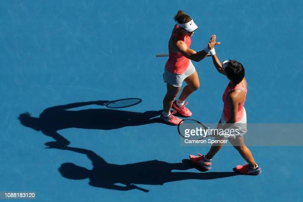 Samantha Stosur of Australia and Shuai Zhang of China celebrate during their Women's Doubles Final match against Timea Babos of Hungary and Kristina...