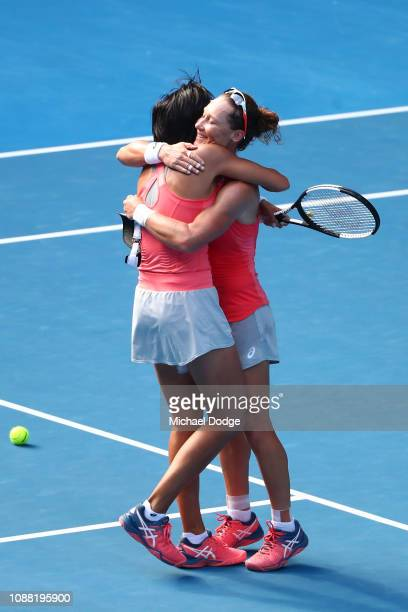 Samantha Stosur of Australia and Shuai Zhang of China celebrate championship point after winning their Women's Doubles Final match against Timea...
