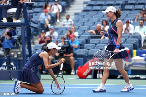 Samantha Stosur of Australia and Shuai Zhang of China celebrate winning championship point against Coco Gauff of the United States and Catherine...