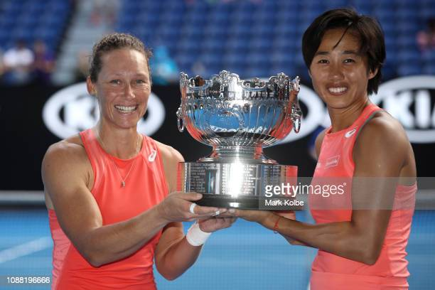 Samantha Stosur of Australia and Shuai Zhang of China pose with the cup after winning their Women's Doubles Final match against Timea Babos of...
