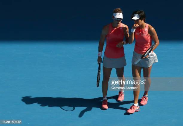 Samantha Stosur of Australia and Shuai Zhang of China talk tactics during their Women's Doubles Final against Timea Babos of Hungary and Kristina...