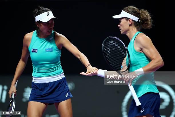 Samantha Stosur of Australia and Zhang Shuai of China celebrate a point against Barbora Krejcikova and Katerina Siniakova of the Czech Republic...