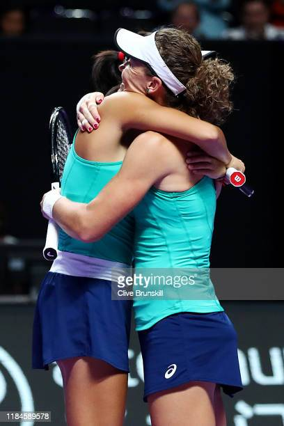 Samantha Stosur of Australia and Zhang Shuai of China celebrate match point against Barbora Krejcikova and Katerina Siniakova of the Czech Republic...