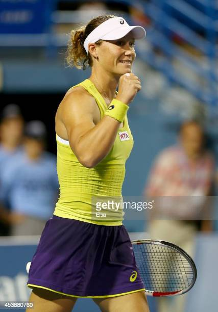 Samantha Stosur of Australia celebrates her match win over Eugenie Bouchard of Canada during the Connecticut Open at the Connecticut Tennis Center at...