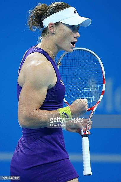 Samantha Stosur of Australia celebrates winning her match against Caroline Wozniacki of Denmark during day five of of the China Open at the National...