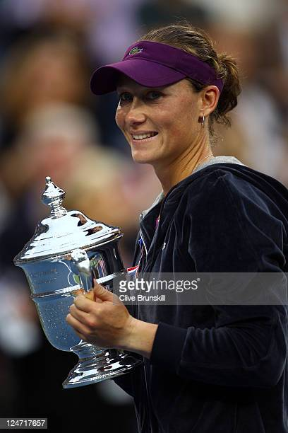 Samantha Stosur of Australia celebrates with the championship trophy defeating Serena Williams of the United States to win the Women's Singles Final...