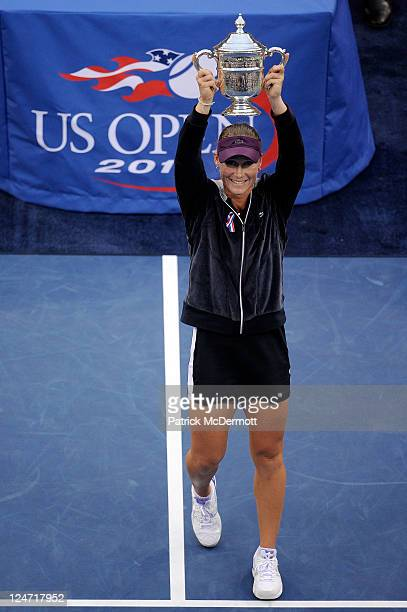 Samantha Stosur of Australia celebrates with the championship trophy after defeating Serena Williams of the United States to win the Women's Singles...