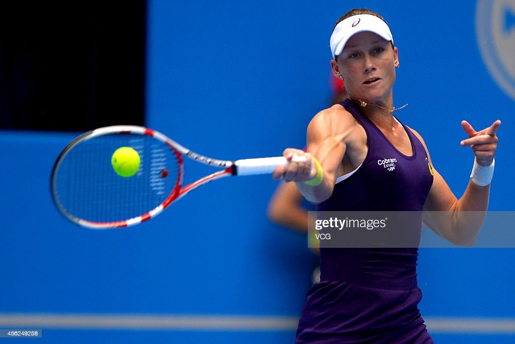 Samantha Stosur of Australia competes with Francesca Schiavone of Italy in day two of 2014 China Open on September 28, 2014 in Beijing, China.