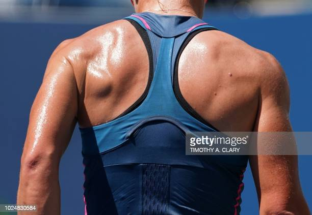 Samantha Stosur of Australia hits the ball against Caroline Wozniacki of Denmark during their Day 2 2018 US Open Women's Singles match at the USTA...