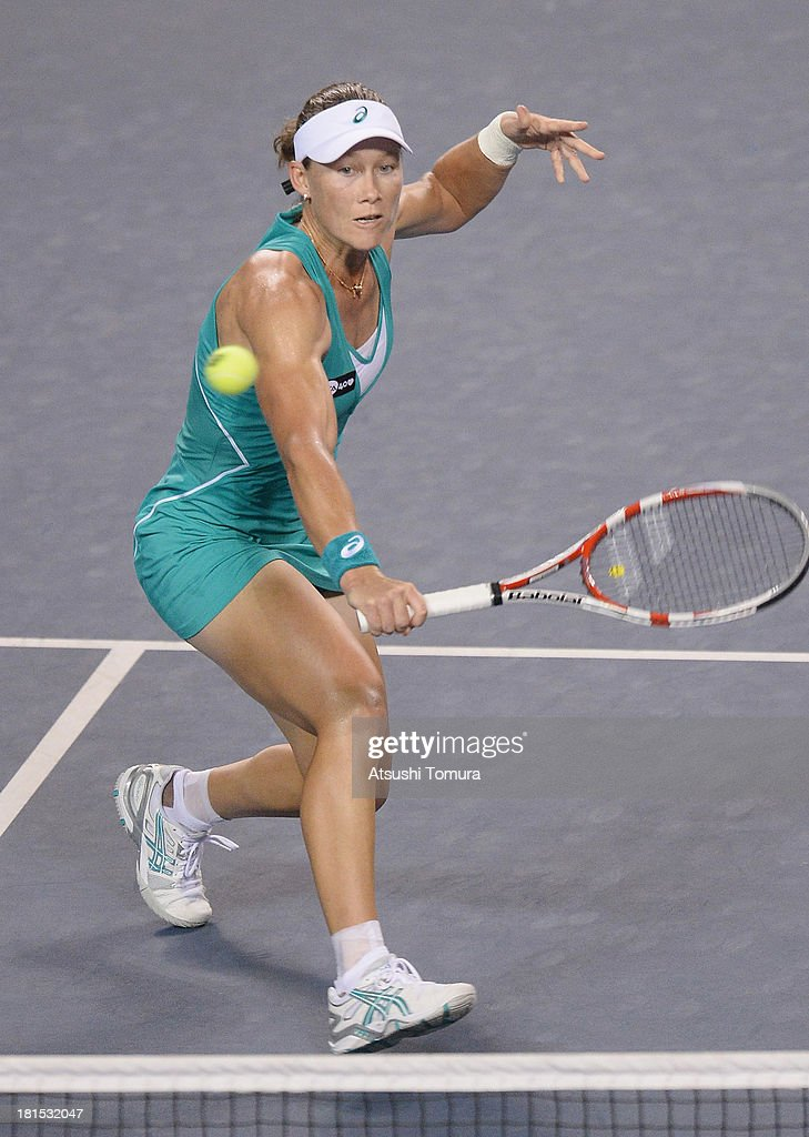 Samantha Stosur of Australia in action during her women's singles first round match against Alize Cornet of France during day one of the Toray Pan Pacific Open at Ariake Colosseum on September 22, 2013 in Tokyo, Japan.