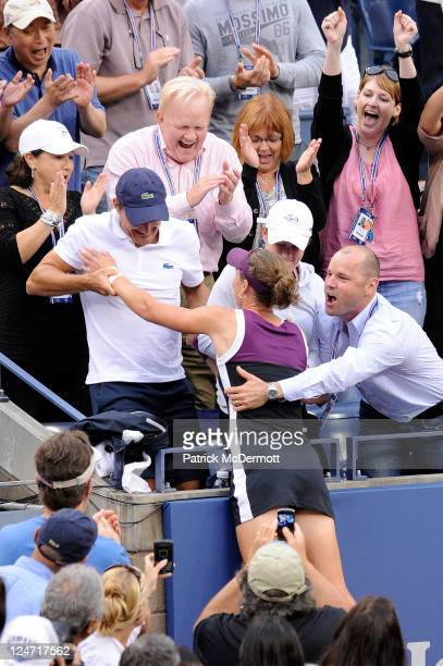 Samantha Stosur of Australia is assisted into her players' box while celebrating her win over Serena Williams of the United States during the Women's...