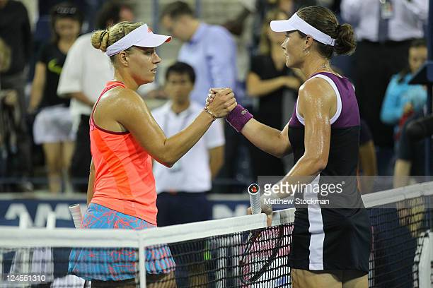 Samantha Stosur of Australia is congratulated by Angelique Kerber of Germany after Stosur won their match during Day Thirteen of the 2011 US Open at...