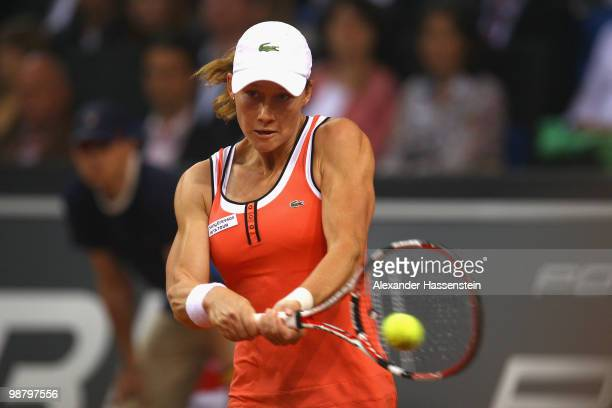 Samantha Stosur of Australia plays a back hand during her final match against Justin Henin of Belgium at the final day of the WTA Porsche Tennis...