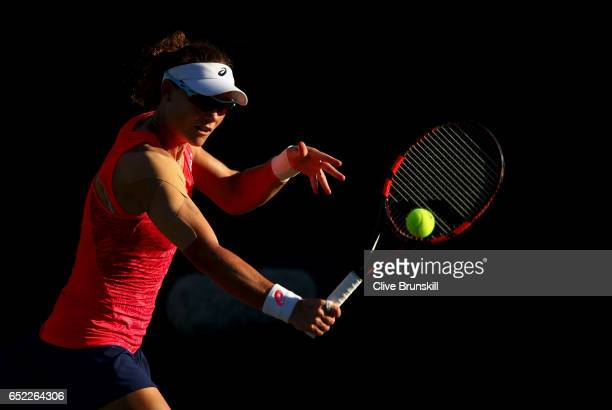 Samantha Stosur of Australia plays a backhand against Julia Goerges of Germany in their second round match during day six of the BNP Paribas Open at...