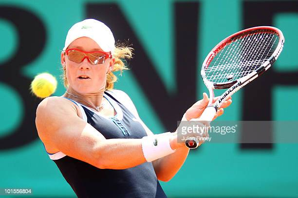 Samantha Stosur of Australia plays a backhand during the women's singles quarter final match between Serena Williams of the United States and...