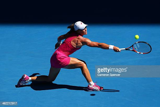 Samantha Stosur of Australia plays a backhand in her first round match against Klara Zakopalova of the Czech Republic during day one of the 2014...