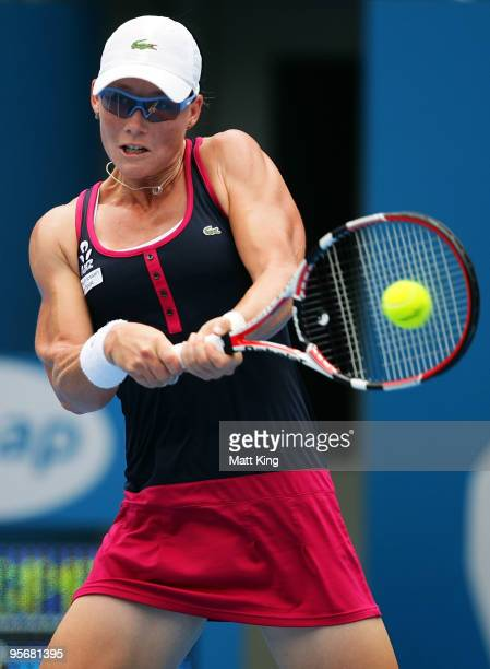 Samantha Stosur of Australia plays a backhand in her first round match against Flavia Pennetta of Italy during day two of the 2010 Medibank...