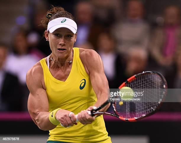 Samantha Stosur of Australia plays a backhand in her single match against Angelique Kerber of Germany during the Fed Cup 2015 World Group First Round...