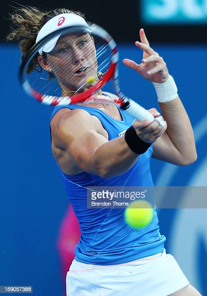 Samantha Stosur of Australia plays a forehand in her first round match against Jie Zheng of China during day two of the Sydney International at...