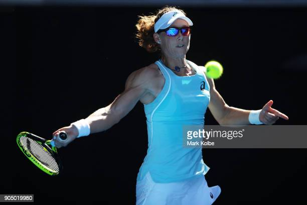 Samantha Stosur of Australia plays a forehand in her first round match against Monica Puig of Puerto Rico on day one of the 2018 Australian Open at...