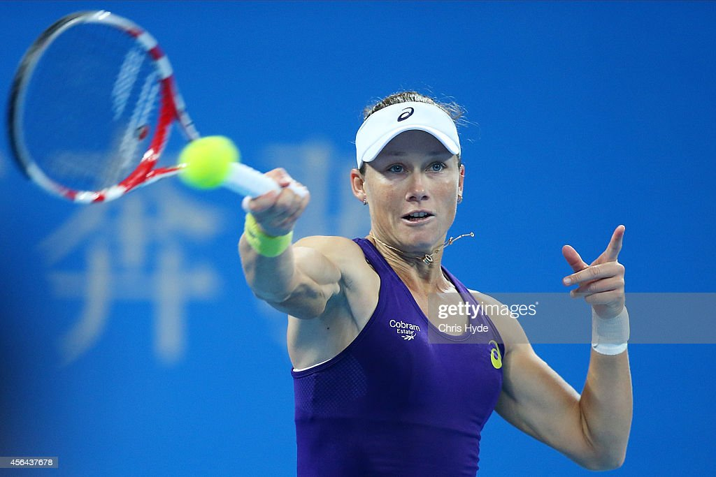 Samantha Stosur of Australia plays a forehand in her match against Caroline Wozniacki of Denmark during day five of of the China Open at the National Tennis Center on October 1, 2014 in Beijing, China.