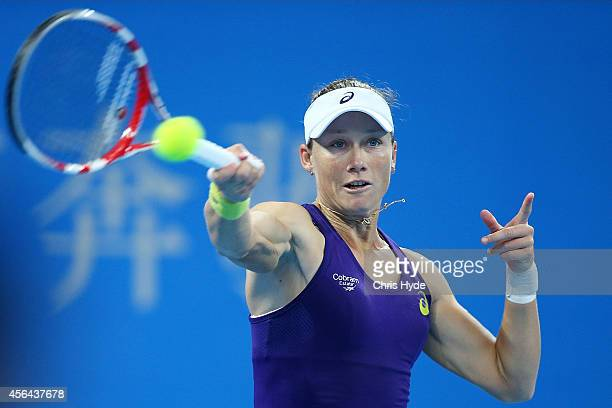 Samantha Stosur of Australia plays a forehand in her match against Caroline Wozniacki of Denmark during day five of of the China Open at the National...