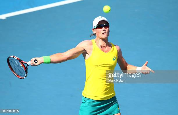 Samantha Stosur of Australia plays a forehand in her singles match against Victoria Kan of Russia during the Fed Cup tie between Australia and Russia...