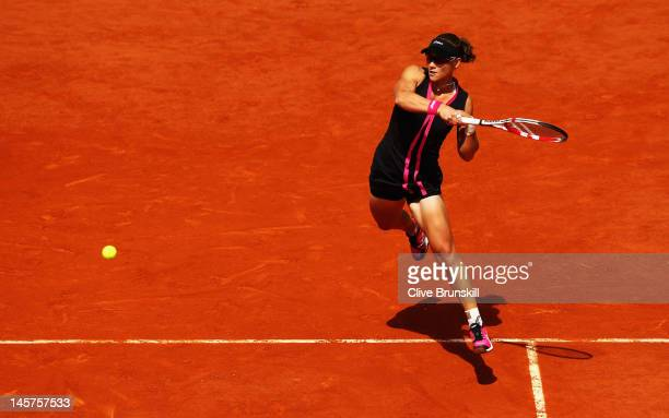 Samantha Stosur of Australia plays a forehand in her women's singles quarter final match against Dominika Cibulkova of Slovakia during day 10 of the...