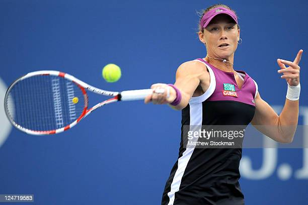 Samantha Stosur of Australia returns a shot against Serena Williams of the United States during the Women's Singles Final on Day Fourteen of the 2011...