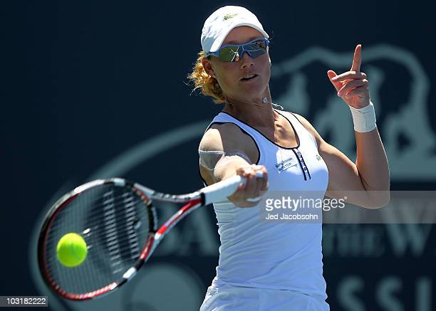 Samantha Stosur of Australia returns a shot against Victoria Azarenka of Belarus during the semifinals of the Bank of the West Classic at Stanford...