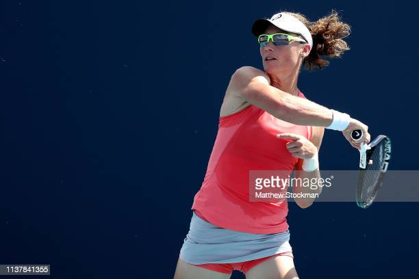 Samantha Stosur of Australia returns a shot to Ashleigh Barty of Australia during the Miami Open Presented by Itau at Hard Rock Stadium March 23 2019...