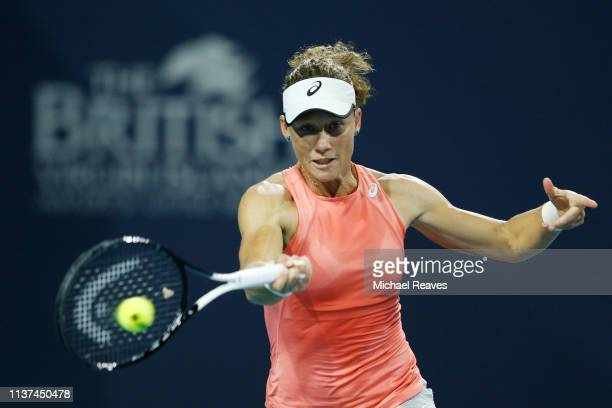 Samantha Stosur of Australia returns a shot to Madison Keys of the United States during Day 4 of the Miami Open Presented by Itau at Hard Rock...