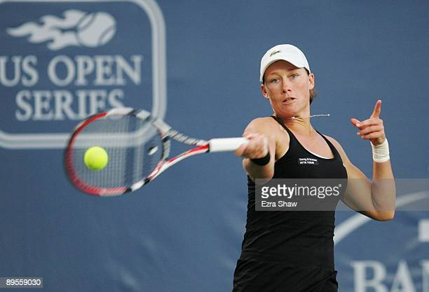 Samantha Stosur of Australia returns a shot to Marian Bartoli of France during their semifinal match on Day 6 of the Bank of the West Classic August...