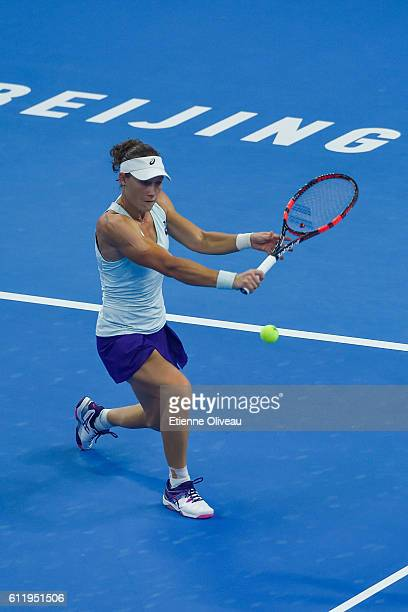 Samantha Stosur of Australia returns a shot to Zhang Shuai of China during the Women's singles first round match on day two of the 2016 China Open at...