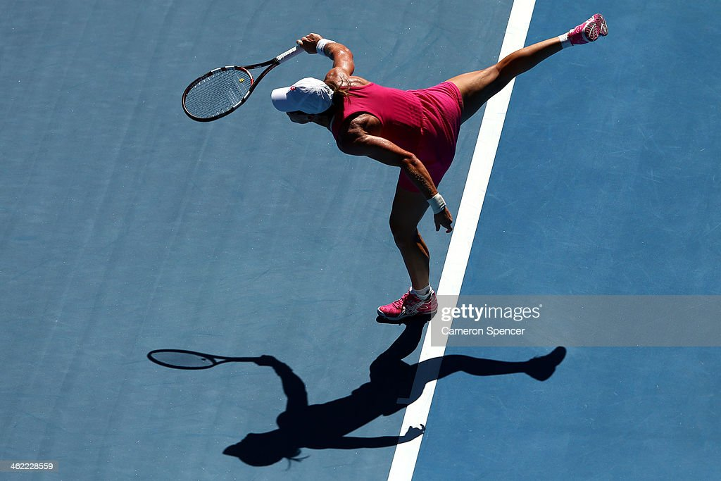 Samantha Stosur of Australia serves in her first round match against Klara Zakopalova of the Czech Republic during day one of the 2014 Australian Open at Melbourne Park on January 13, 2014 in Melbourne, Australia.