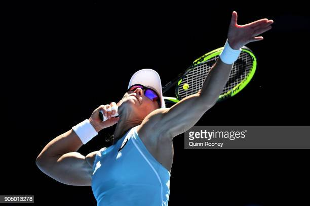 Samantha Stosur of Australia serves in her first round match against Monica Puig of Puerto Rico on day one of the 2018 Australian Open at Melbourne...