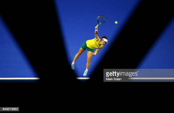 Samantha Stosur of Australia serves in her match against Lesley Kerkhove of the Netherlands during the World Group PlayOff Fed Cup tie between...