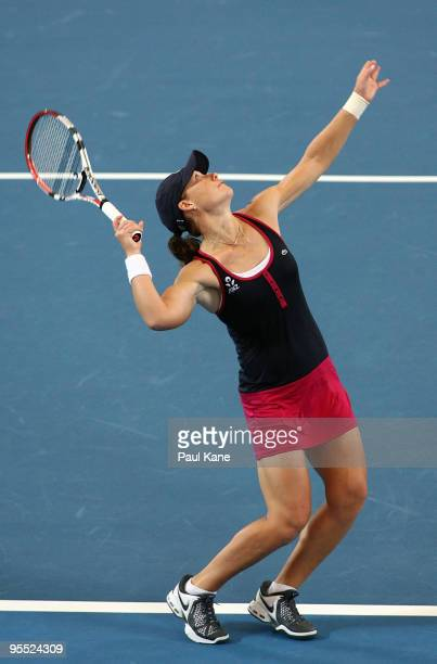 Samantha Stosur of Australia serves in her match against Sorena Cirstea of Romania in the Group A match between Australia and Romania during day one...