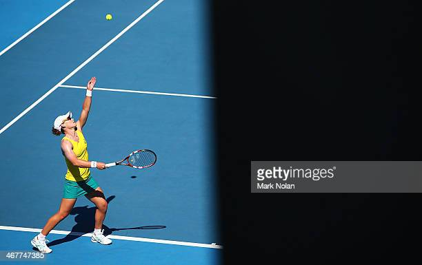 Samantha Stosur of Australia serves in her singles match against Veronica Kudermetova of Russia during the Fed Cup tie between Australia and Russia...