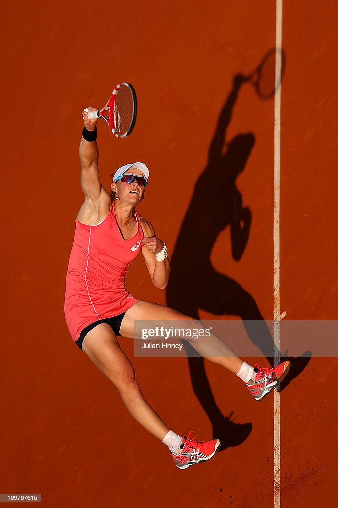 Samantha Stosur of Australia serves in her Women's Singles match against Jelena Jankovic of Serbia during day seven of the French Open at Roland Garros on June 1, 2013 in Paris, France.