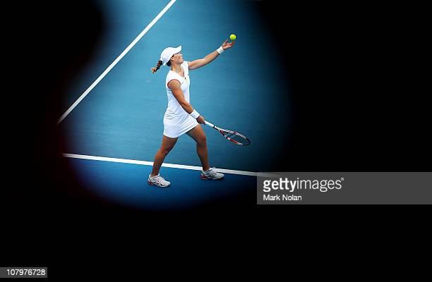 Samantha Stosur of Australia serves in the game against Svetlana Kuznetsova of Russia during day three of the 2011 Medibank International at Sydney...