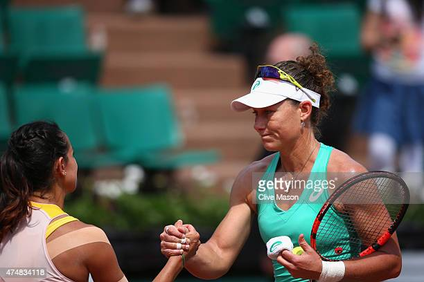 Samantha Stosur of Australia shakes hands with Amandine Hesse of France after winning her Women's Singles match during day four of the 2015 French...