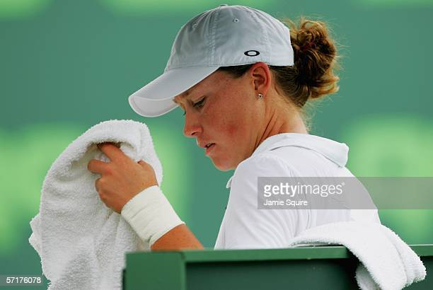 Samantha Stosur of Australia sits between games against Amelie Mauresmo of France in the women's second round of the Nasdaq-100 Open, part of the...