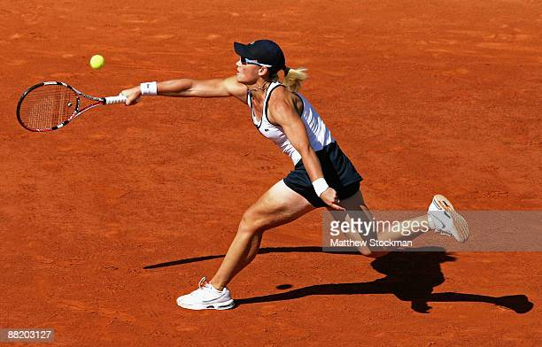 Samantha Stosur of Australia stretches to hit a forehand during the Women's Singles Semi Final match against Svetlana Kuznetsova of Russia on day...