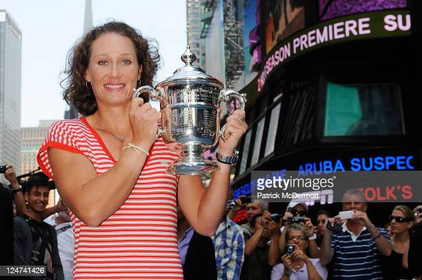 Samantha Stosur of Australia the 2011 US Open Champion poses with the trophy in Times Square on September 12 2011 in New York City Stosur defeated...